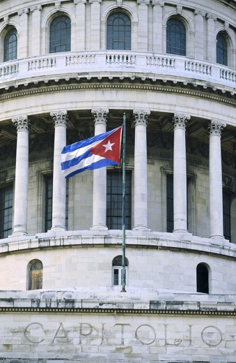 Cuban flag in front of government building, Capitolio, Havana, Cuba : Stock Photo