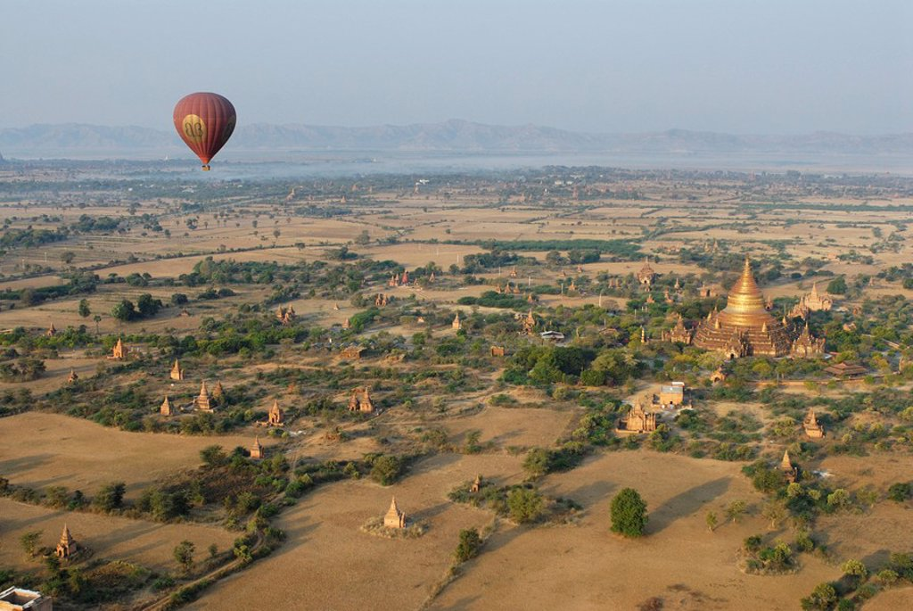 Stock Photo: 1841-29262 Hot air balloon above Buddhist stupa, Bagan, Myanmar