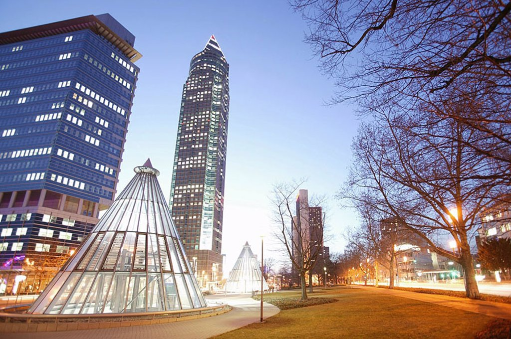 Skyscrapers lit up in city, Messeturm Tower, Frankfurt, Hesse, Germany : Stock Photo