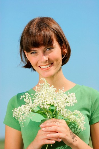 Stock Photo: 1841-30704 woman holding a bunch of flowers