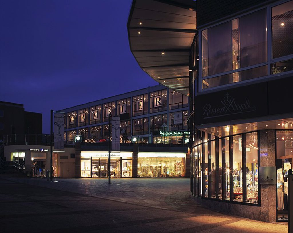 Shopping mall lit up at dusk : Stock Photo