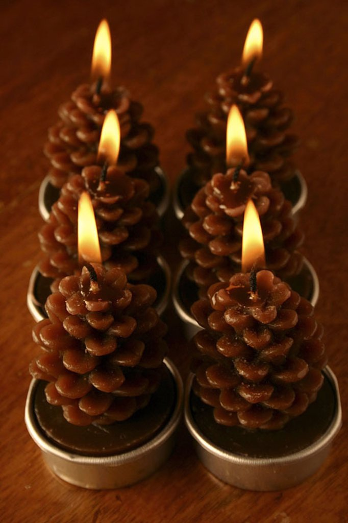 High angle view of pine cones shape lit candles : Stock Photo