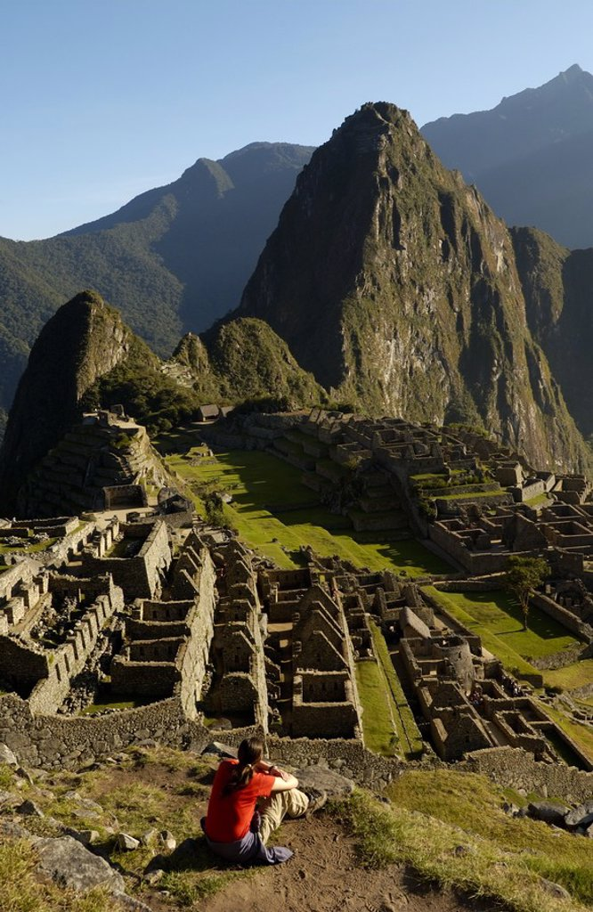 Tourist looking at old ruins on mountain, Inca Ruins, Machu Picchu, Cusco Region, Peru : Stock Photo