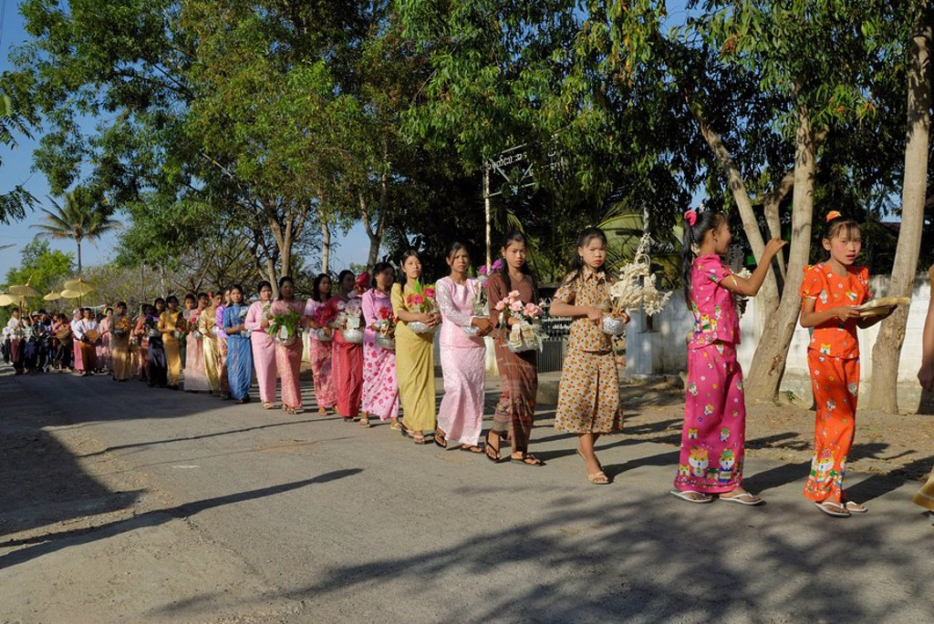 Group of women and girls walking in row with religious offerings, Nyaung Shwe, Inle Lake, Myanmar : Stock Photo