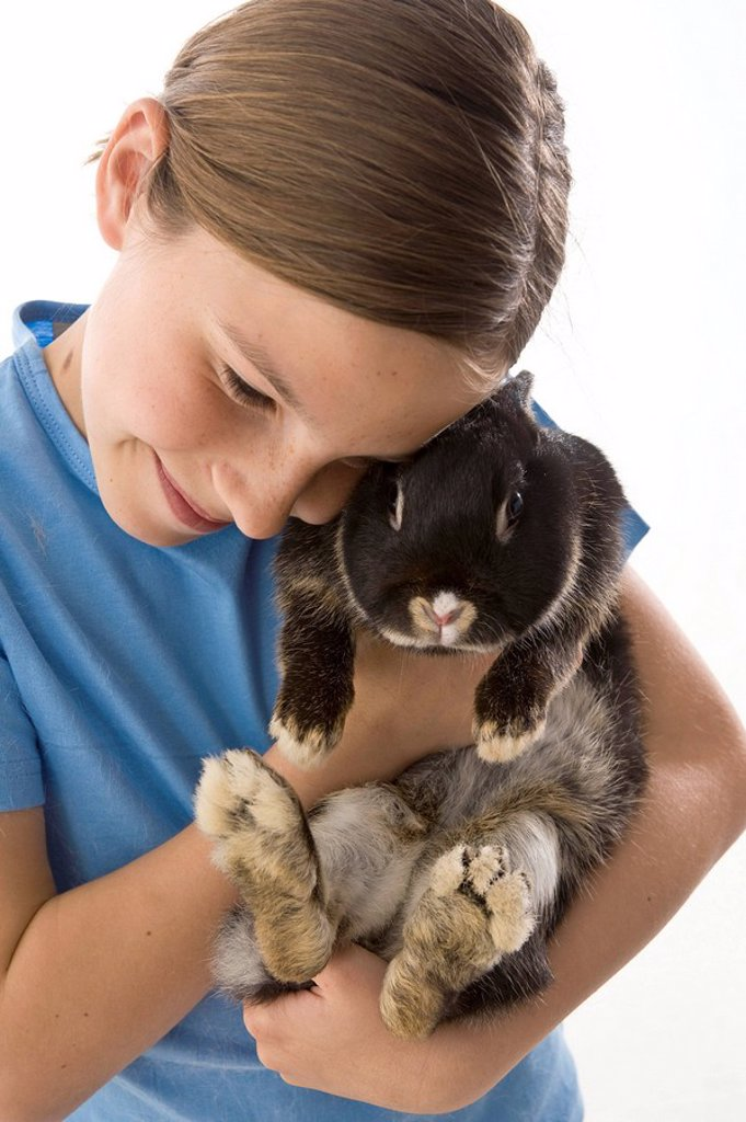 Girl holding a rabbit, Studio Shot, close_up : Stock Photo
