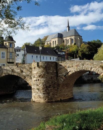 Stone bridge with church in background, Elbbach Bridge, Hadamar, Westerwald, Hesse, Germany : Stock Photo