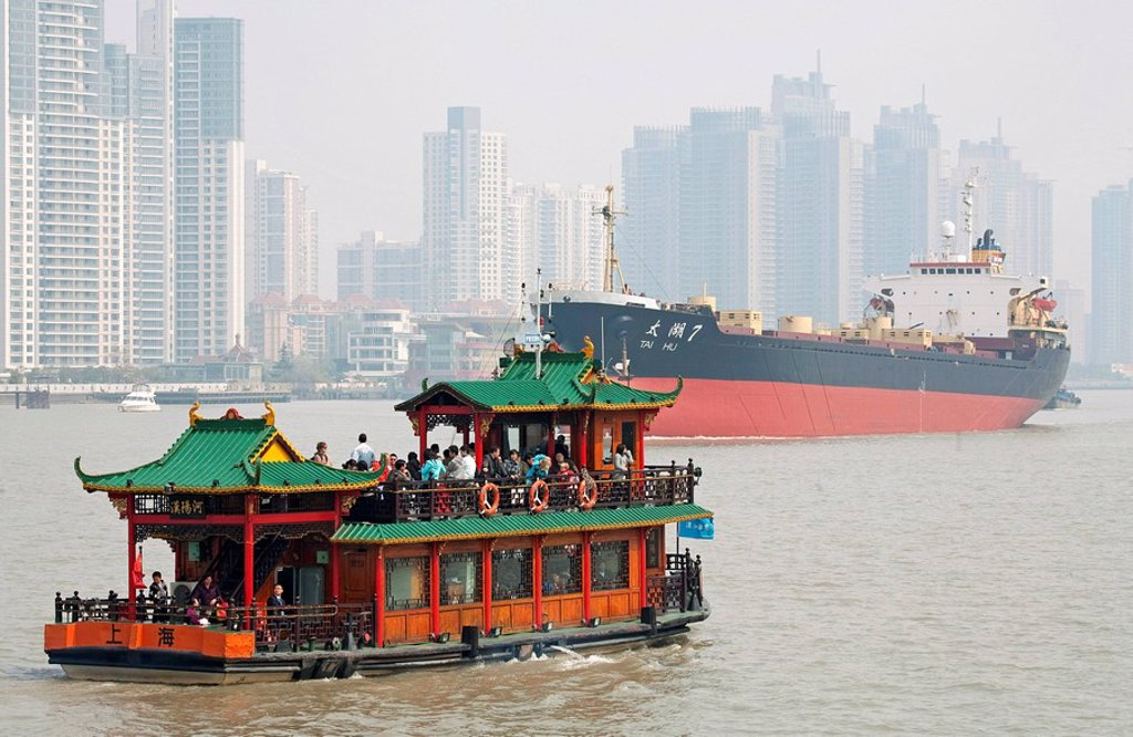 Ferry and ship on a river, Skyscrapers in the background, Shanghai, China : Stock Photo