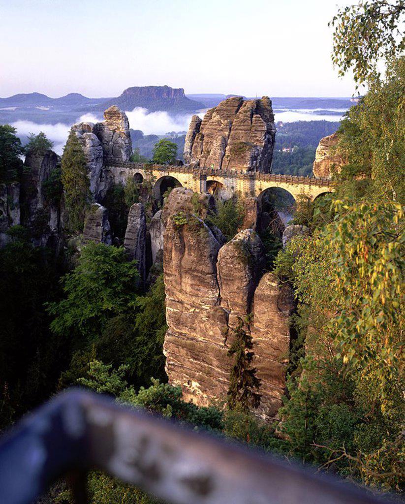 Bridge passing through cliffs, Bastei Bridge, Saxon Switzerland National Park, Dresden, Saxony, Germany : Stock Photo