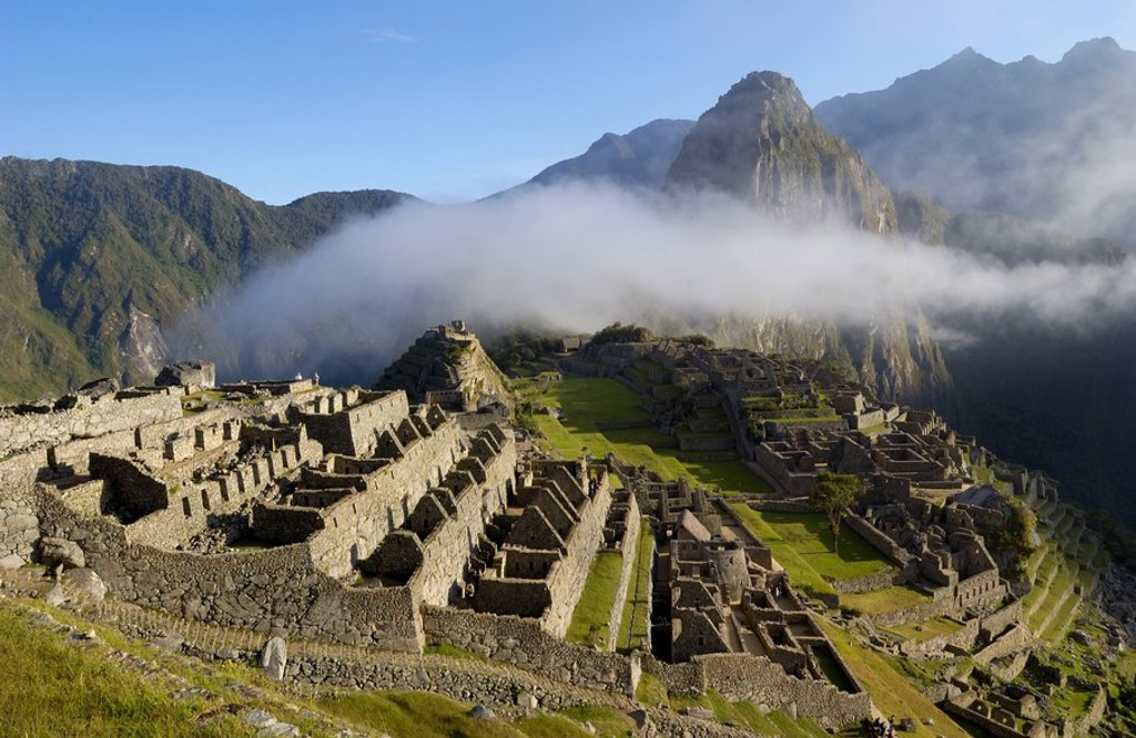 Clouds over old ruins on mountain, Inca Ruins, Machu Picchu, Cusco Region, Peru : Stock Photo