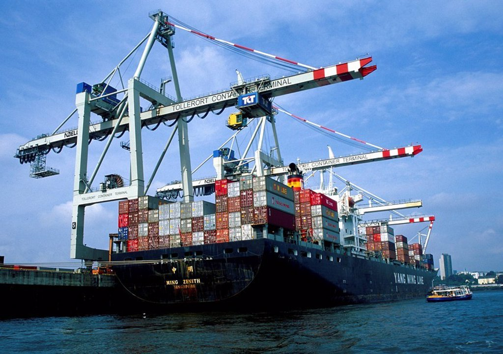 Low angle view of cargo containers on ship at harbor, Hamburg, Germany : Stock Photo