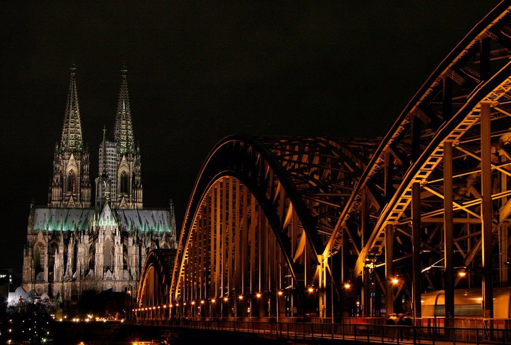 Cathedral and bridge lit up at night, Hohenzollern Bridge, Cologne Cathedral, Cologne, Rhineland, North Rhine_Westphalia, Germany : Stock Photo
