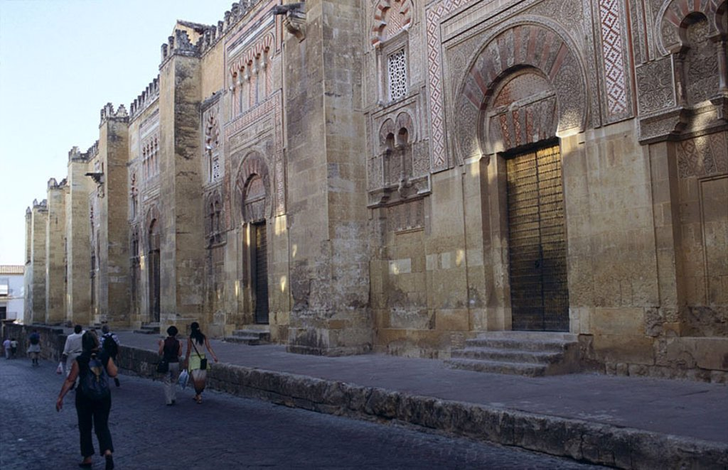 People walking in front of mosque, Mezquita Catedral de Cordoba, Cordoba, Andalusia, Spain : Stock Photo