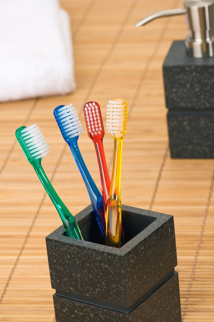 Close_up of toothbrushes in holder : Stock Photo