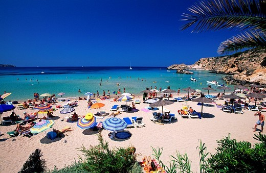 Tourists on beach, Cala Tarida Beach, Ibiza, Balearic Islands, Spain : Stock Photo