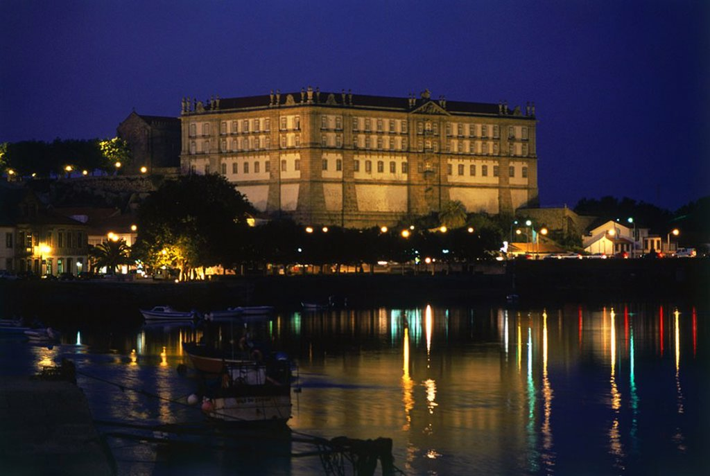 Cathedral at waterfront lit up at night, Convent Of Santa Clara, Duoro River, Portugal : Stock Photo