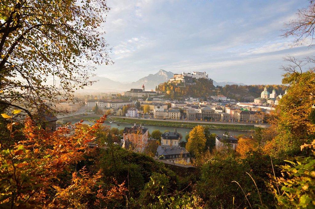 High angle view of buildings at waterfront, Salzach River, Kajetanerkirche, Stift Nonnberg, Untersberg, Salzburg, Austria : Stock Photo
