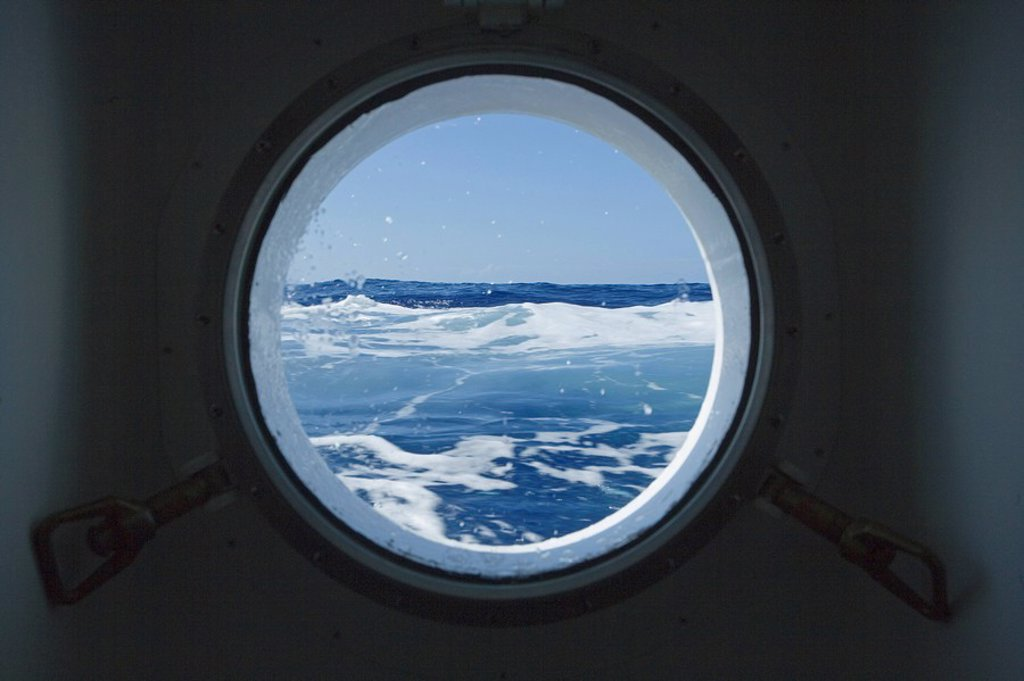 Porthole of an cruise ship on Pacific : Stock Photo