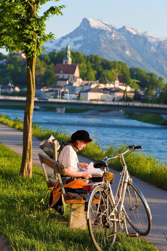 Woman reading book in park, Moenchsberg, Untersberg, Salzach, Salzburg, Austria : Stock Photo