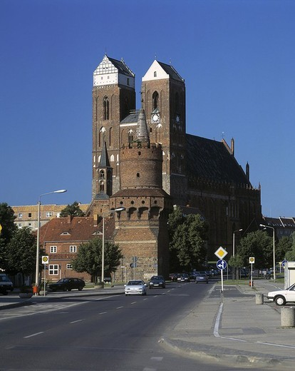 Cars on road in front of cathedral, Brandenburg, Germany : Stock Photo