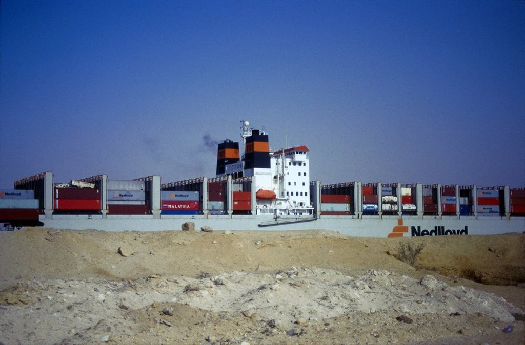 Cargo ship in canal against blue sky, Suez Ship Canal, Egypt : Stock Photo