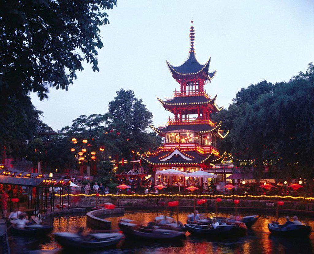 Stock Photo: 1841-49396 People boating in front of lit up pagoda, Tivoli Gardens, Copenhagen, Denmark