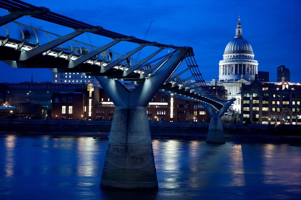 Bridge across river lit up at night, Millennium Bridge, St. Pauls Cathedral, London, England : Stock Photo