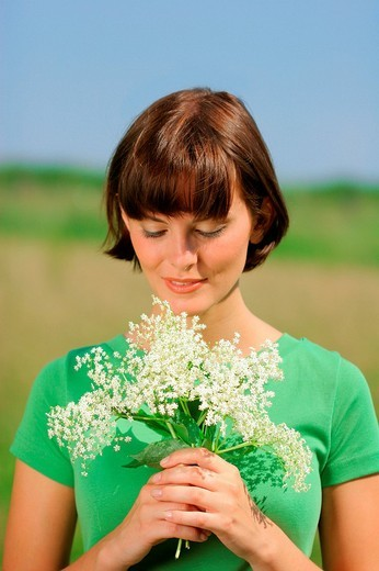 woman holding a bunch of flowers, portrait : Stock Photo