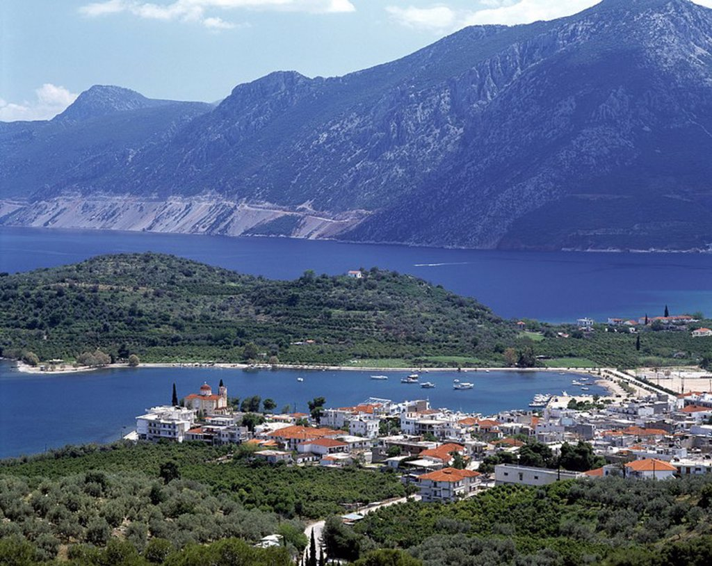Aerial view of town with mountain in background, Epidaurus, Greece : Stock Photo