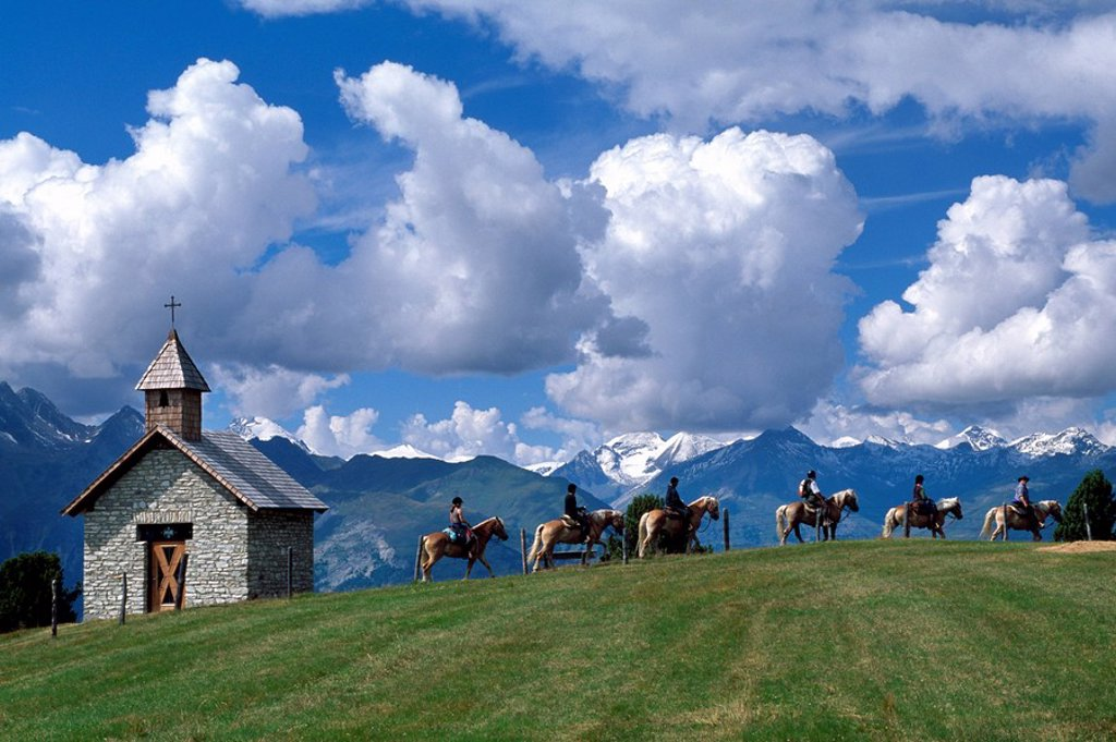 Tourists riding on horses with mountain range in background, Hohe Tauern, Alps, Moelltal, Carinthia, Austria : Stock Photo