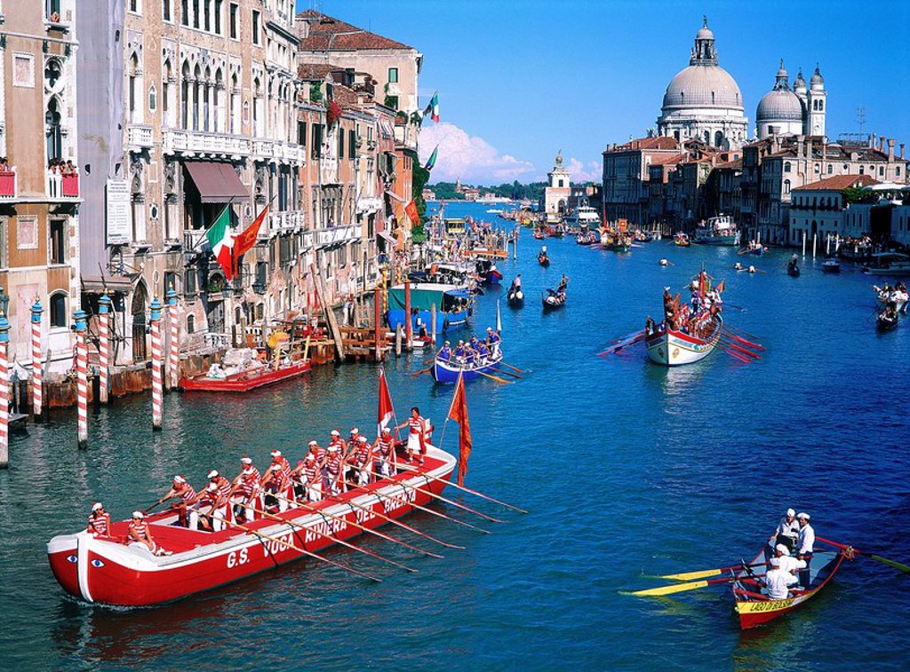 Stock Photo: 1841-53103 Boatmen rowing boats in canal, Grand Canal, Santa Maria Della Salute, Venice, Italy