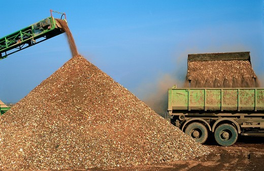 Sand heap beside a dump truck : Stock Photo