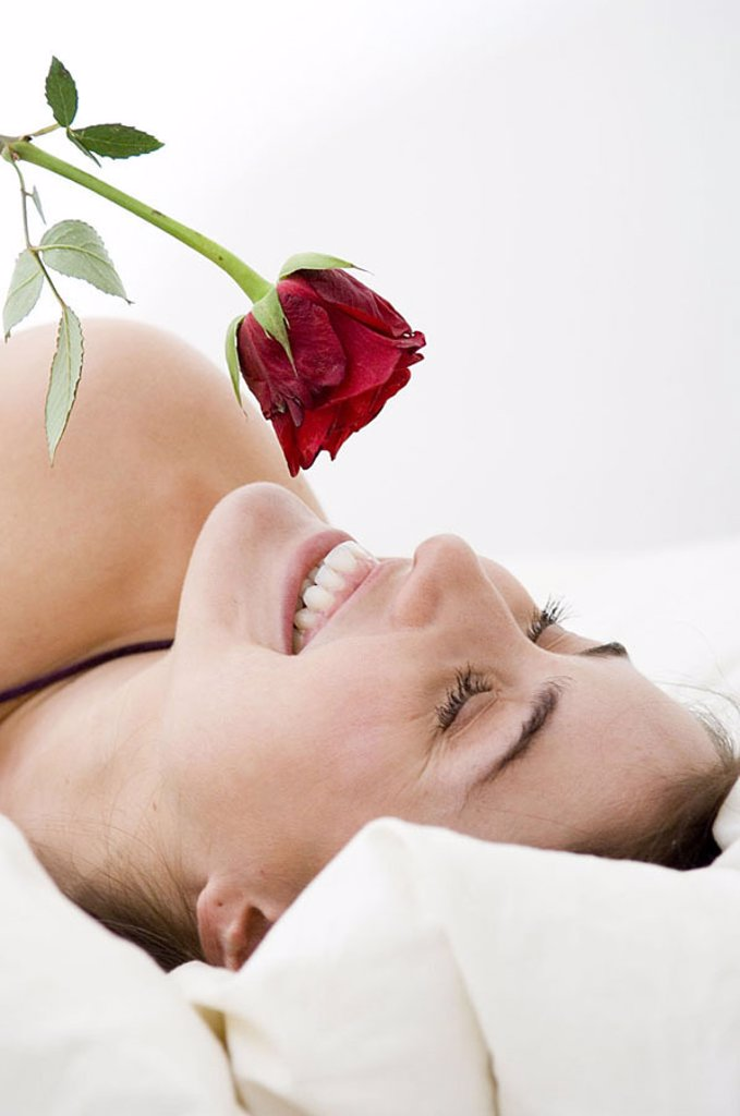 Young woman with red rose : Stock Photo