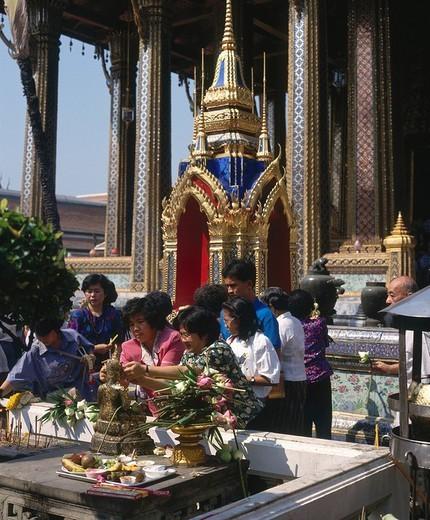 Stock Photo: 1841-53937 People praying in temple, Wat Phra Kaeo, Bangkok, Thailand