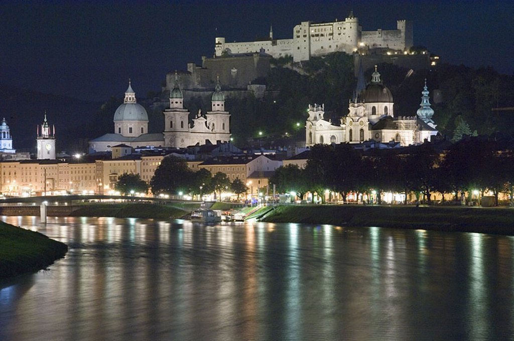Buildings on waterfront, Hohensalzburg Castle, Salzburg, Austria : Stock Photo