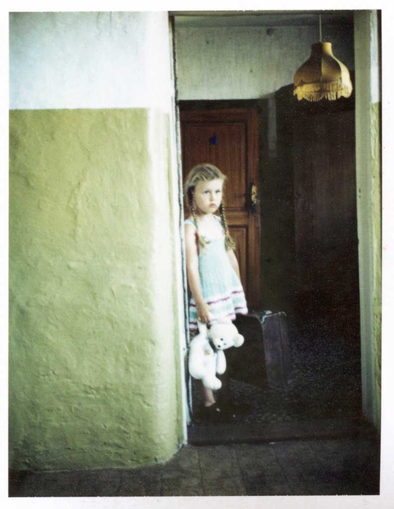 Stock Photo: 1841-54814 Girl with teddy bear and suitcase