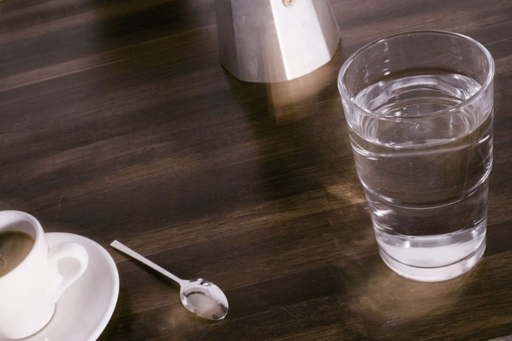 Close_up of glass of water and cup of coffee : Stock Photo
