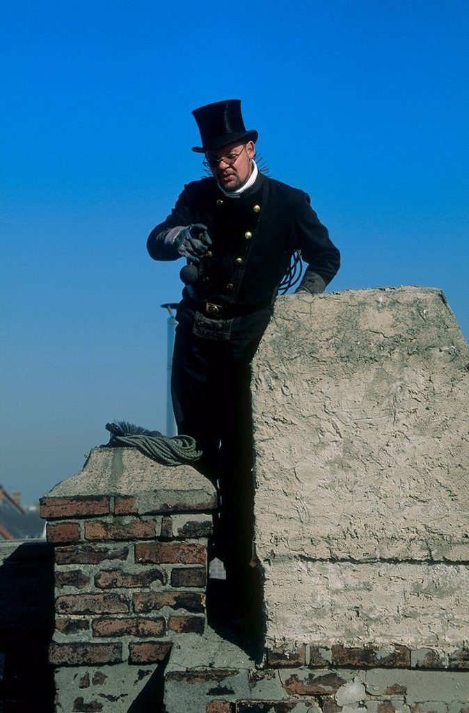 Stock Photo: 1841-59689 Man cleaning chimney