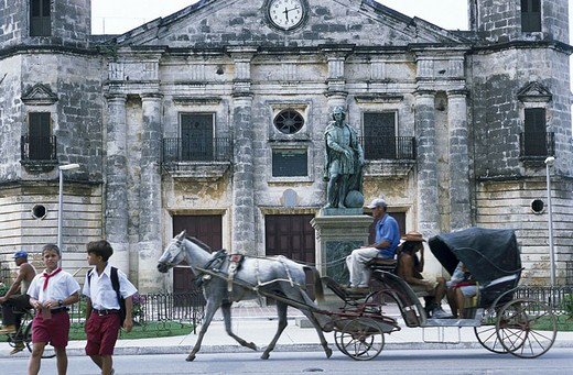 Stock Photo: 1841-6027 Horse cart on road in front of sculpture, Matanzas Province, Cuba