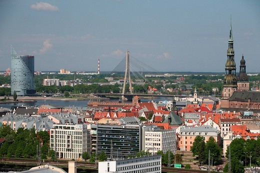 View over Riga with the Church of St. Peter and the Shroud Bridge, Latvia, aerial view : Stock Photo