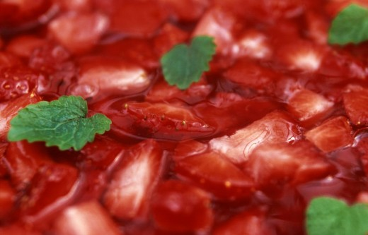 Close_up of slices of strawberries and mint leaves : Stock Photo