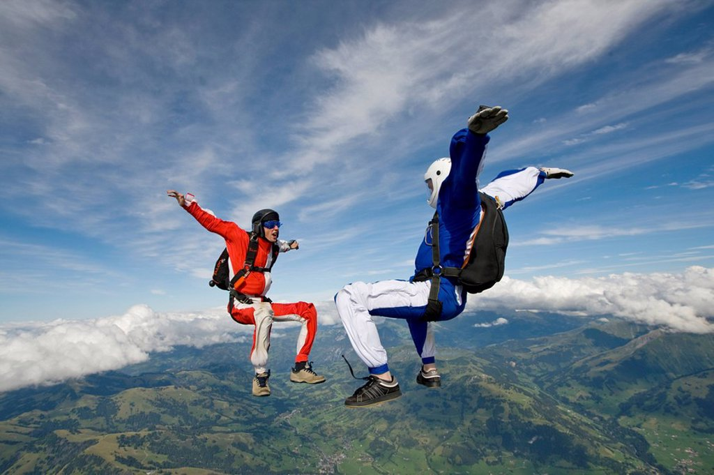 two people doing parachute jumping, full shot : Stock Photo