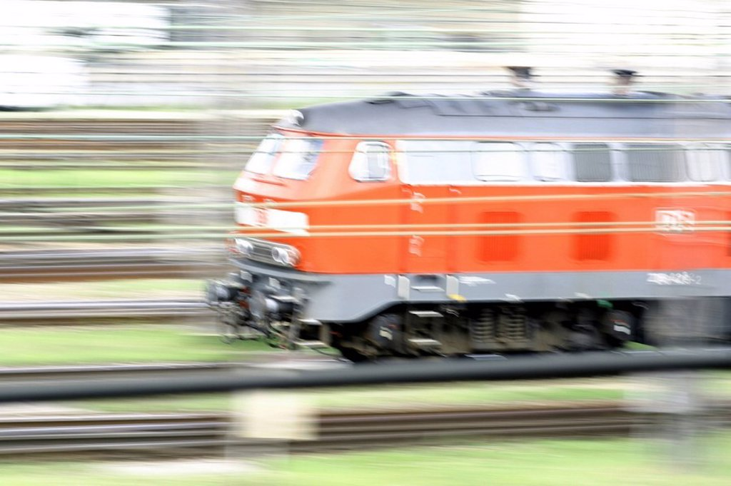 Blurred view of train engine on track, Germany : Stock Photo