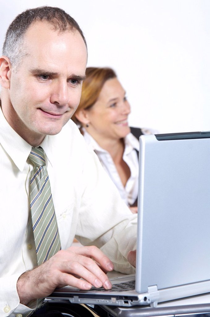 Close_up of businessman using laptop : Stock Photo