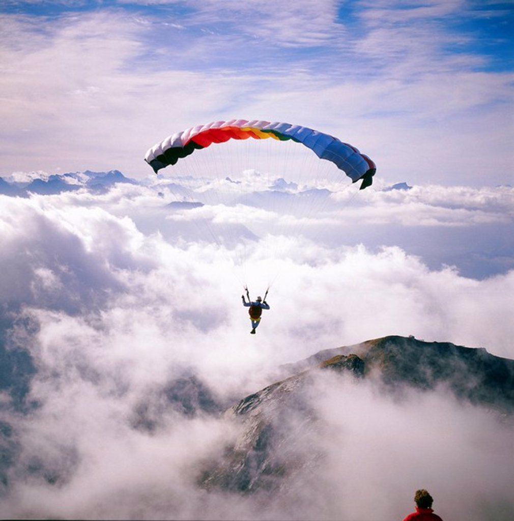 Stock Photo: 1841-9945 Paraglider paragliding over mountain range, Allgaeu, Bavaria, Germany