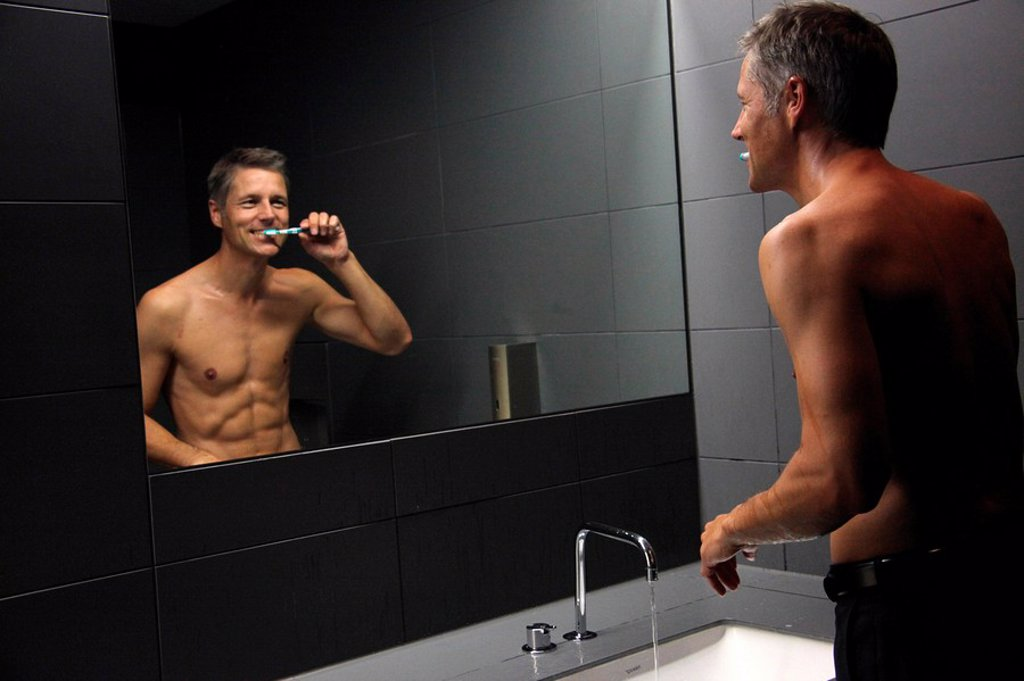 Stock Photo: 1841-99535 Man brushing teeth