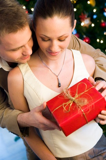 Stock Photo: 1841R-102921 couple giving themself christmas presents