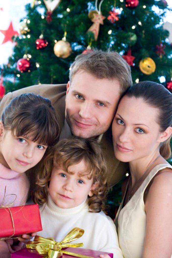 portrait of a family next to christmas tree : Stock Photo