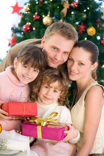 portrait of a family next to christmas tree : Stock Photo