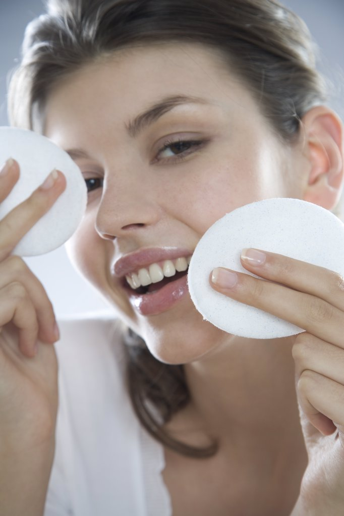 woman cleaning face : Stock Photo