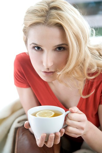 woman drinking lemon tea : Stock Photo